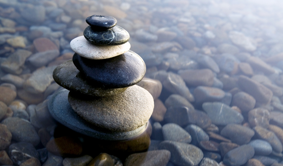 Zen Balancing Rocks on Pebbles covered with water.